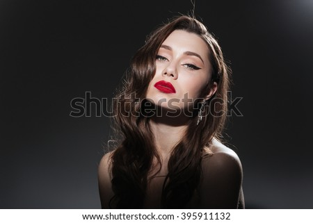Beauty portrait of a young charming woman with fresh skin on black background - stock photo
