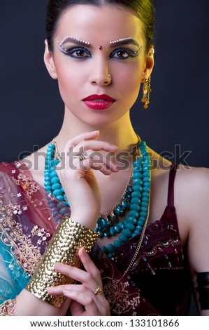 Beauty portrait of a young indian woman in traditional clothing - stock photo