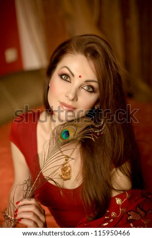 Beauty portrait of a young indian woman in traditional clothing with bridal makeup and jewelry - stock photo