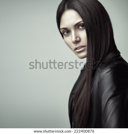 Beauty portrait of a young sensual model with long straight brown hair.