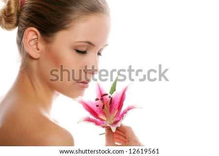 beauty portrait of a young woman isolated on white background with a flower - stock photo