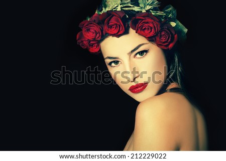 beauty portrait of a young woman with a wreath of red roses on her head, black background - stock photo