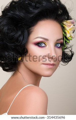 Beauty portrait of adult woman with retro styled fashion salon make-up.