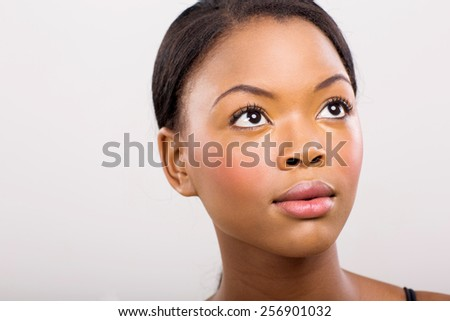beauty portrait of african american girl looking up - stock photo