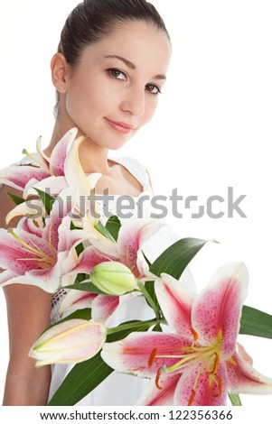 Beauty portrait of an attractive young woman with pink japanese lily flowers, isolated on a white background. - stock photo