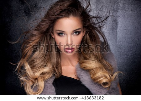 Beauty portrait of attractive sensual young woman with glamour makeup.