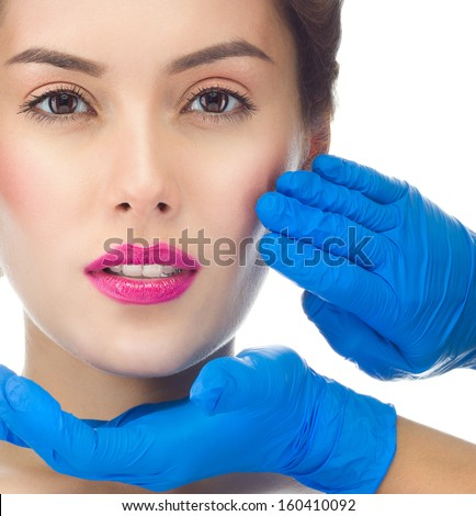 beauty portrait of attractive young caucasian woman brunette, face, skin, hands; isolated on white, studio shot, head and shoulders - stock photo