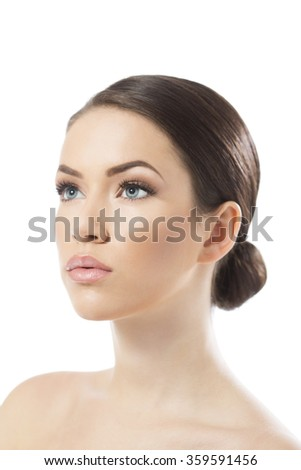Beauty portrait of beautiful young woman looking at camera, isolated on white - stock photo