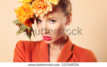 Beauty portrait of blonde elegant woman with autumn flowers in head. Conceptual photo. - stock photo