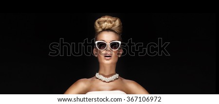Beauty portrait of elegant attractive blonde woman wearing pearls and stylish sunglasses. Fashionable hairstyle. - stock photo