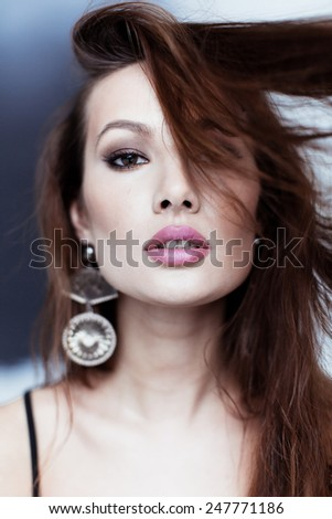 Beauty portrait of girl in top with sequins - stock photo