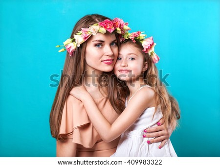 Beauty portrait of mother and daughte. Mothers day - stock photo