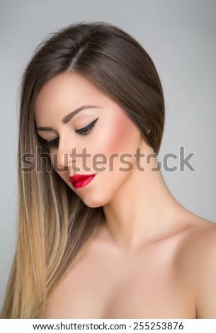 Beauty portrait of sad girl looking down - stock photo