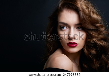 beauty portrait of sexy brunette with red lips isolated on black - stock photo
