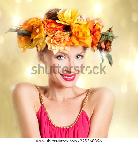 Beauty portrait of smiling young attractive woman with autumn flowers on head. Conceptual photo. - stock photo