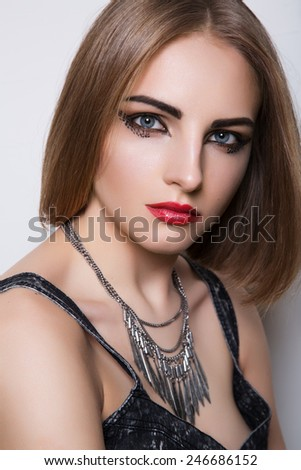 Beauty portrait of the impudent girl with red lips