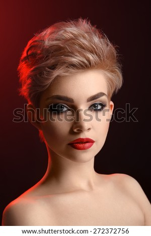 Beauty portrait of women on black background with red