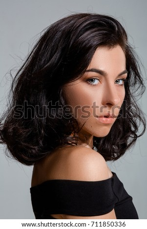 Beauty portrait of young adorable fresh looking brunette woman with brown healthy hair.