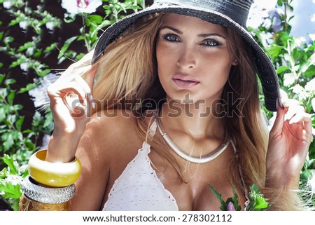 Beauty portrait of young attractive woman. Summer photo. - stock photo