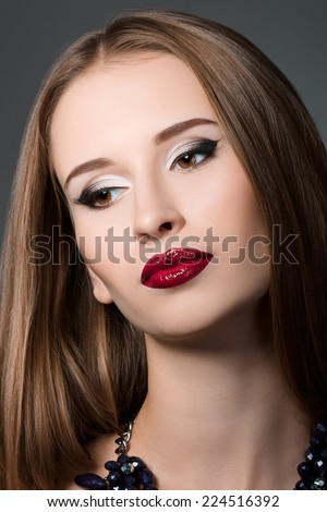 Beauty portrait of young brown-haired woman with evening make-up