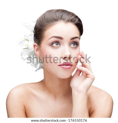 beauty portrait of young caucasian brunette woman with flowers in hair isolated on white