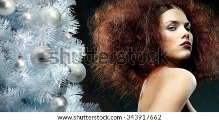 beauty portrait of young caucasian woman face skin makeup hair style lips looking at camera head and shoulders black background fashion christmas tree new year - stock photo