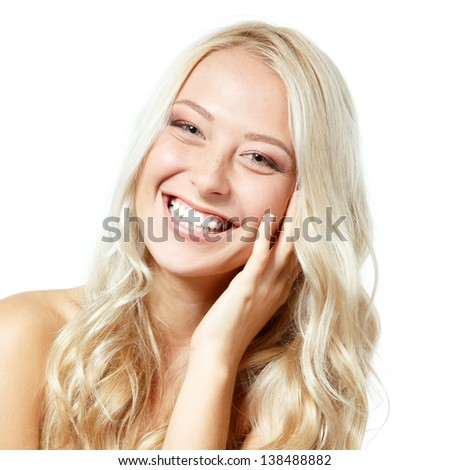 Beauty portrait of young happy smiling blonde girl. Isolated on white background