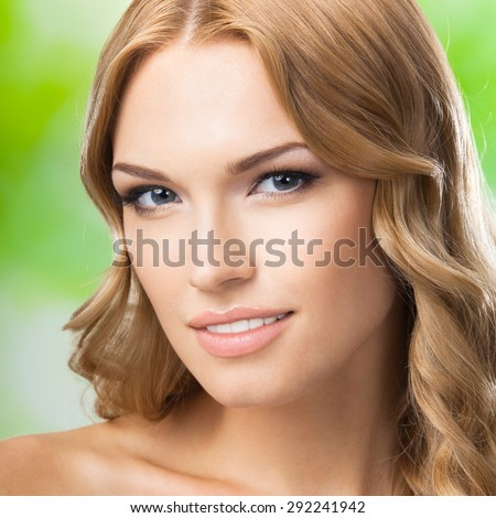 Beauty portrait of young lovely blond woman, outdoors