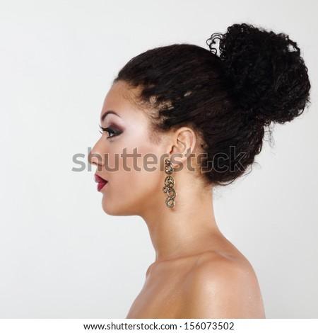 Beauty portrait of young mulatto fresh fashion woman in profile - stock photo