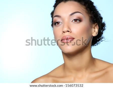Beauty portrait of young mulatto fresh fashion woman with beautiful makeup - stock photo