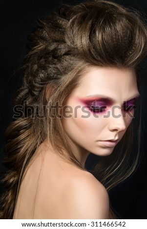 Beauty portrait of young pretty girl with fashion make-up