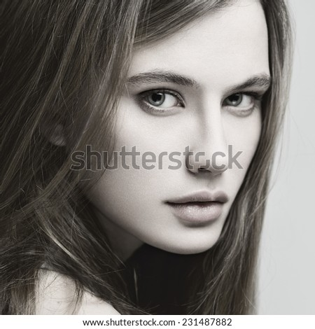 Beauty portrait of young sexy model with long straight hair.