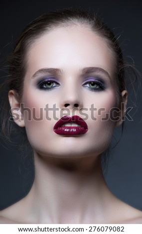 Beauty portrait of young sexy woman on dark background - stock photo