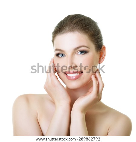 Beauty portrait of young smiling woman with beautiful healthy face, studio shot of attractive girl over white background - stock photo