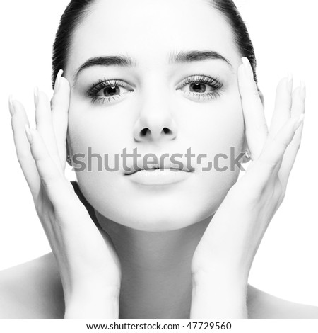 Beauty Portrait of young woman. Face in hands. Black and White