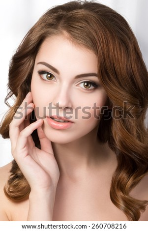 Beauty portrait of young woman touching her face. SPA concept - stock photo