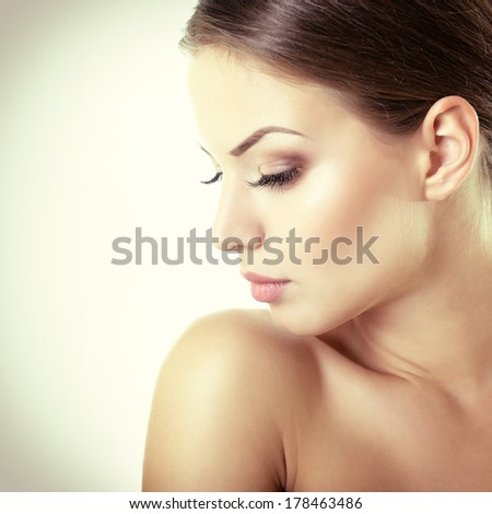 Beauty portrait of young woman with beautiful healthy face in profile, studio shot of attractive girl, toned. - stock photo