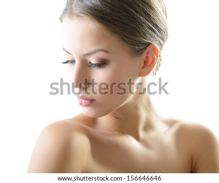 Beauty portrait of young woman with beautiful healthy face with nice makeup looking at camera, studio shot of attractive girl over white background - stock photo