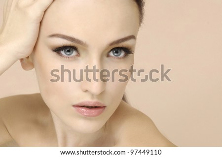 Beauty portrait of young woman with healthy skin on a face - stock photo