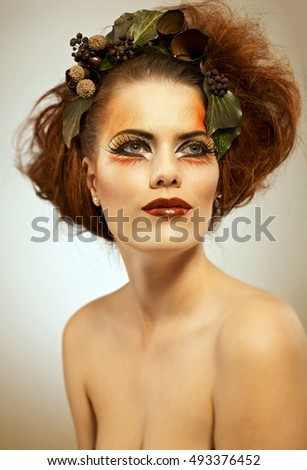 Beauty portrait redhead woman in autumn makeup