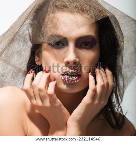 Beauty portrait young woman  holding her face between hands.  - stock photo