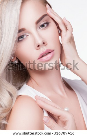 Beauty portrait young woman with beautiful healthy face.White hair.Studio shot of attractive girl over white background. beauty make-up.Blond woman close-up of her blue eyes looking into the camera - stock photo