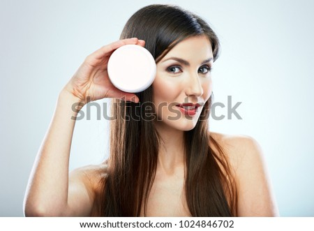 Beauty portrait young woman with skin care cream. Isolated studio background.
