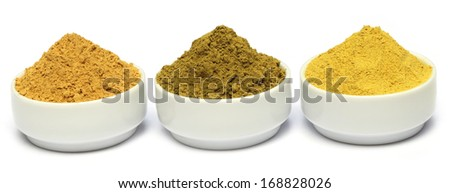 Beauty powders on ceramic bowl over white background