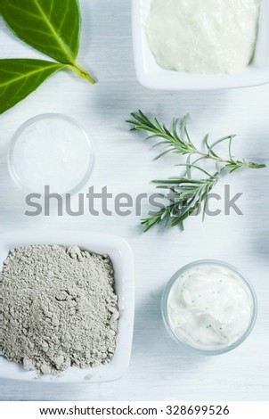 beauty products, cosmetic clay powder and cream on white wooden table background