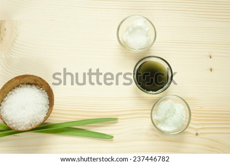 beauty products on natural wooden table background - stock photo
