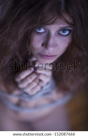 beauty redhaired woman bondage rope - stock photo