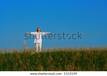 beauty redheaded girl in field