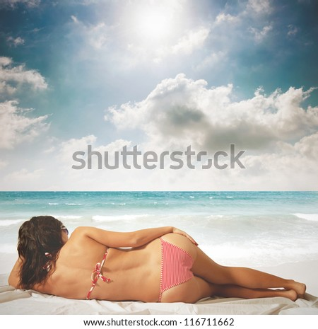 Beauty relaxing against a blue sea