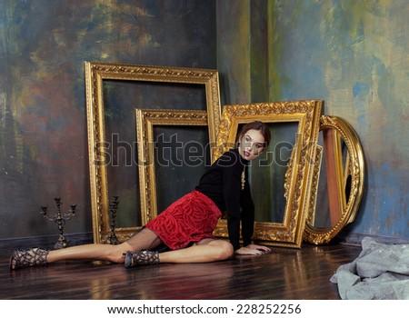 beauty rich brunette woman in luxury interior near empty frames, vintage elegance - stock photo